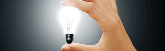 holding a light bulb shows idea generation