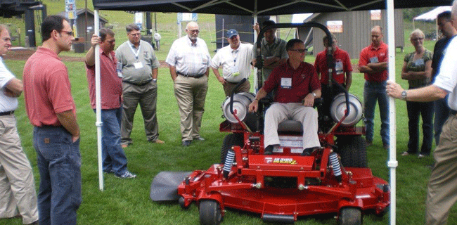 demonstrating operation of a propane mower