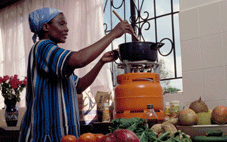 woman cooking with LP gas