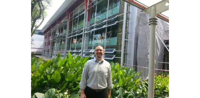 Ross Brindle in front of building.
