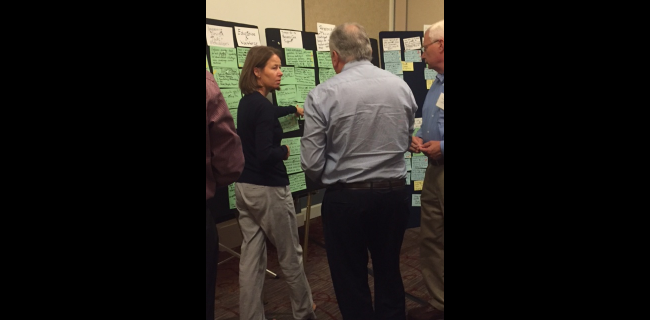 Participants adding cards to a storyboard at a REMADE Institute roadmapping workshop meeting.
